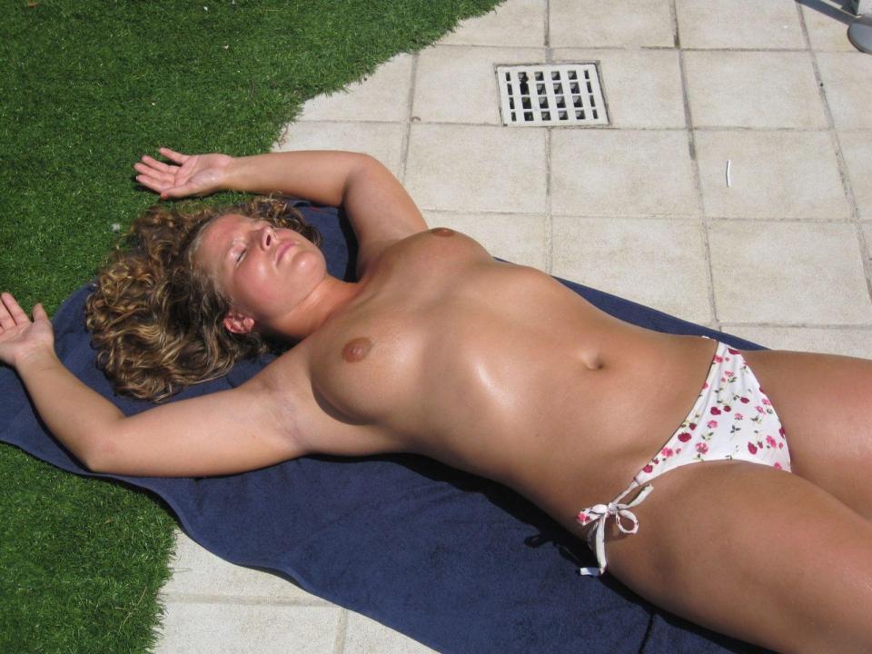 naked sun bathing spread