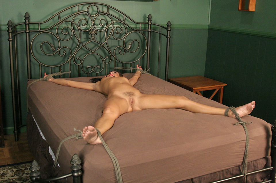 Tied to bed spread eagle