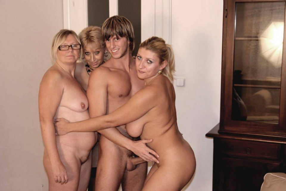 nudist family sitting on the couch