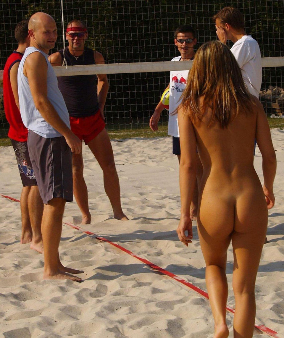 Sexy girl playing beach volleyball stock photo