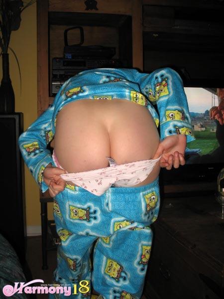 teen girl pulling down pajamas full size